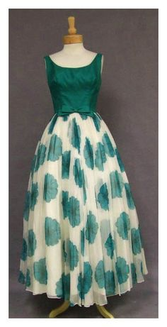 1960's Evening Dress-  sleeveless, princess style and a higher waist were popular in the 1960s. The feminine yet bold and bright pattern and colors show the style of the day.