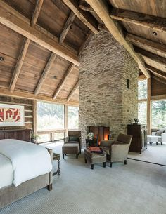 rustic home design. Rustic stone and timber dwelling overlooking the Grand Tetons. (Image Courtesy of JLF Architects)