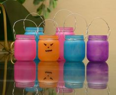 Made in Mommyland: Reuse baby food jars: Tea light candle holders  elmers glue, children's paint, then clear spray. Let the glue/paint mix set for 5 or 10 minutes before you paint to prevent dripping.