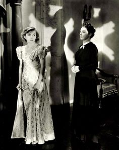 Joan Fontaine and Judith Anderson in publicity still for Hitchcock's Rebecca (1940)