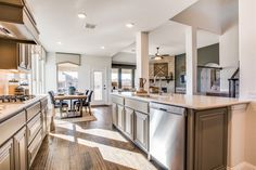 Enjoy cooking and hanging out in our open floor plan! Bloomfield Homes, Large Family Rooms, Home And Family, Real Estate Website Design, Open Kitchen, Kitchen Island, Garden Tub, Two Story Homes, Real Estate Services