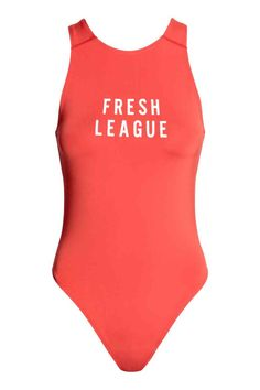 Sports body: Sleeveless body in fast-drying functional fabric with a print motif on the front, high-cut legs and a lined gusset with press-studs.