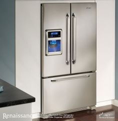 This would be perfect for my kitchen.  Stainless steel fridge with french doors, blue LCD digital display and a bottom freezer. Dacor ef36iwfss