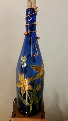 Hey, I found this really awesome Etsy listing at https://www.etsy.com/listing/211343172/hand-painted-wine-bottle-lamp