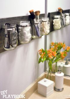 We love our mason jar organizer DIY project and today we're showing you how you can easily clean the jars for this bathroom essential.
