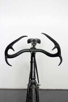 LOVE it! The Moniker Cycle Horn is a handcrafted handlebar by Brooklyn designer Taylor Simpson that combines real deer antlers with recycled materials.