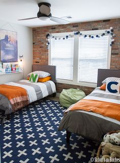 shared boys bedroom with exposed brick wall | #bedroomdesign kids bedroom #sweetdesginideas modern design #kidsroom . See more inspirations at www.circu.net