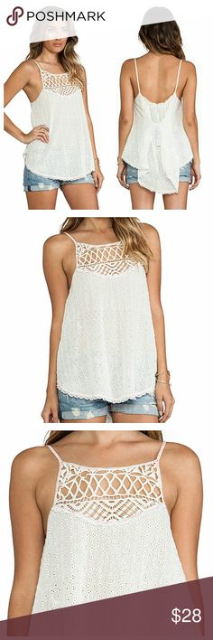 """Free People Boho Eyelet Tunic """"I've got my eyelet on you"""" tank in great shape. It's sheer and can be worn over a bralette. Rear ties for a custom fit. Armpit to Armpit 17 - Length 26. Free People Tops Tunics"""