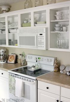 Open shelves in the kitchen.- maybe try this before takin cabinets all the way down