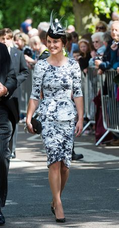 Attending a friend's wedding, Pippa looked lovely in a black and white peplumTabitha Webb dress andOlivia Roat Millinery fascinator. via StyleList