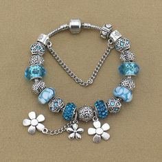 Diy Jewelry, Jewelery, Jewelry Design, Pandora Bracelets, Pandora Jewelry, Charm Braclets, Pandora Style Charms, Flower Bracelet, Blue Beads