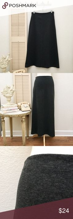 Maxi Skirt, Heavy-weight Jersey, Elongated A-line. 98% acrylic, 2% polyester. Waist band: 1 1/4 inch wide elastic. Waist: 14.5 inches across measured flat. Hip: 19 inches across measured flat. Length: 37.5 inches from waist to hem. Hemline at widest point, 28 inches across. Color: charcoal gray. Labeled size medium. Skirt has natural stretch but enough structure to give you support. This item is used and in good to very good condition. The skirt would be fabulous with boots !❤️ Michele…