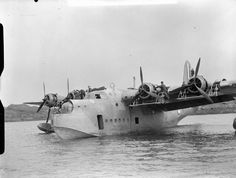 Groundcrew performing a routine overhaul on a Short Sunderland Mark I of No. 210 Squadron RAF, moored in Oban Bay, Scotland.