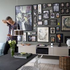 Beautiful picture wall. Adam in Copenhagen shows us round his home | live from IKEA FAMILY LIVE |   Featuring RIBBA frames Assorted sizes. Black