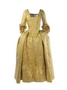 A bright yellow Chinese silk damask dress. The robings, folds running alongside the edge of the bodice, and falling cuffs are trimmed with matching ruched ribbon. Cut in one piece with a falling-front skirt, sack-back, and provision for hoops, an underskirt stiffened with whalebone or bone to provide the desired shape. The bodice and sleeves are lined with natural plain-weave linen; the skirt is half-lined with rough, tabby weave cream English worsted. The fabric is a typical Chinese silk damask in its pattern.  Production Date: 1751-1770