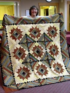 I like the border of this quilt - and the cool use of black - I now that lady!!!  That is Sue from Country Treasure in Chester, Vermont!!!  They have THE BEST FABRIC for making Quilts!!!  <3 <3 <3!!!