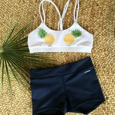 Pina Colada Surf N' Yoga Sports Bra and Shorts can be worn during your workout or used as a bathing suit for a day in the water. This is the perfect outfit for your happy active lifestyle  Get yours now at www.lovesurf.com  #LoveSurf #SurfNyoga #active #lifestyle #happy #pineapple