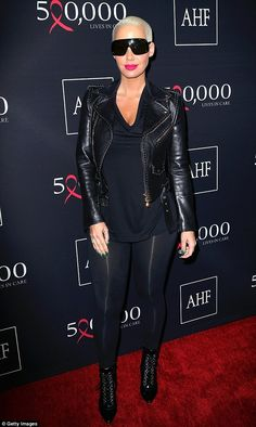 Cool customer: Amber Rose opted for a more understated look as she arrived in all-black to...