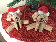 Set of 2 Wine Cork Puppy Dog Christmas Tree Ornaments. These ornaments are handmade from wine corks, squiggly eyes, black button noses, red & white striped ribbon bows, red Santa hats and an eye screw for easy hanging. Add these adorable handmade ornaments to your Christmas tree,