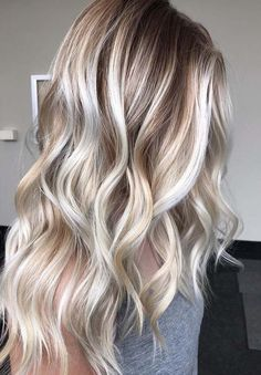 10 Gorgeous Balayage Blonde Highlights with Dark Roots in 2018. Browse this post and find the most beautiful ideas of balayage blonde hair colors, shades and highlights for 2018 with sensational dark roots to make you long locks more elegant than ever nowadays.