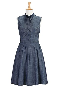 Our casual chambray cotton dress is capped with a smart, mandarin collar and ties at the neckline. The pleated waist nips in the silhouette above a flared skirt that gently swishes as you move.