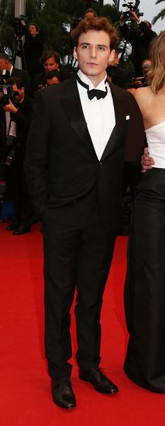 Sam Claflin  Wearing an AW13 black satin rever tuxedo by Alexander McQueen