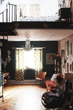 gorgeous loft + chandelier + brick wall + oil portraits