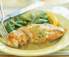 The creamy orange sauce flecked with chopped fresh sage turns skinless, boneless chicken breast halves into elegant fare.