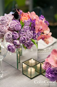 Tulips, roses, orchids, calla lilies and lilacs combine all of spring's best blooms in a single mirrored floral vessel. Colin Cowie Celebrations