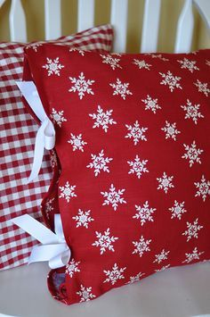 Sew opposite sides of two Target seasonal napkins, add ribbons to the open ends, slip in a pillow and you're done. It make more sense on the website. Try it for any holiday.
