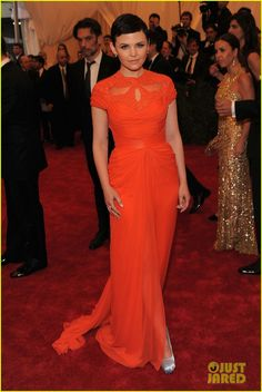 Ginnifer Goodwin walks the red carpet at the 2012 Met Ball in NY wearing a Monique Lhuillier tangerine silk chiffon cap sleeve gown