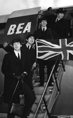 The Beatles return from Paris on BEA flight, landing at London Heathrow Airport 1964.