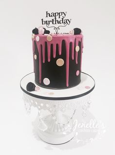 Black and pink drip cake. By Jenelle's Custom Cakes.