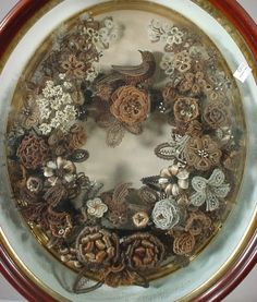 Victorian Hairwork Mourning Art    Very popular is the Victorian and early Edwardian era. This wreath is made from a deceased persons hair. It was a way for loved ones to remember the person who had died.    I have a passion for antique hair art and have my own ever growing collection.