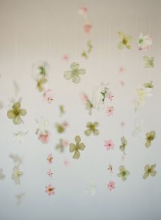 source: Style Me Pretty  ~ pretty hanging flower petals