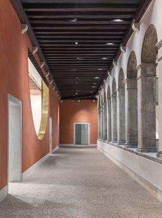 OMA add new entrances and wood-panelled escalators to historic Fondaco dei Tedeschi in Venice