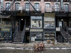 """Oscar-winning production designer Stuart Craig captured a magical version of 1920s New York for the new J. K. Rowling film, Fantastic Beasts and Where to Find Them. The production team built three enormous city streets in a U.K. studio, capturing the gritty feel of Manhattan's neighborhoods at the time. """"We needed different areas and aspects of New York,"""" says Craig. """"Even with the big set that we built, we had a need to make separate, quite distinct areas quite far from each other."""""""