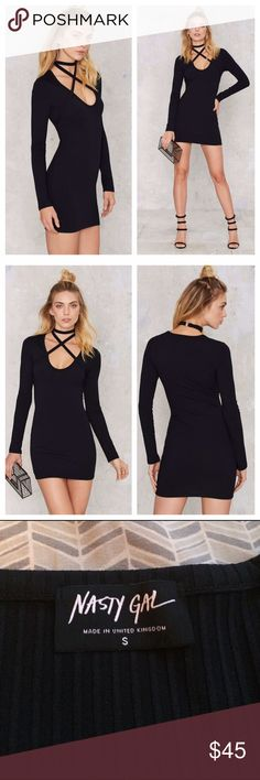 """NEW Nasty Gal Cross and Turn mini dress New without tags, the PERFECT little black dress for a night out on the town. Long sleeve. Super stretchy ribbed fabric. Wrap around criss cross strap that clasps behind neck. 91% polyester 9% elastane. Length 31"""" pit to pit when flat 16"""" but stretches plenty to fit body when worn. Since this is hard to find, price is relatively firm. Nasty Gal Dresses Long Sleeve"""