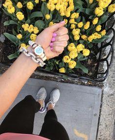 white sports watch yellow tulips