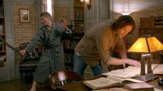 Dean, with the sword, in a bathrobe
