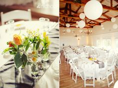 @Vintage Villas White lanterns in the Sunset Room with simple bud vases on the tables.
