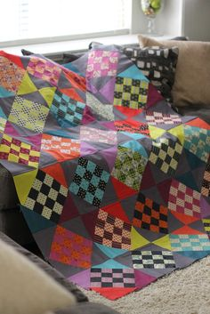Awhile back I mentioned some 12-patch blocks sewn up from a Design Roll of Chicopee by Denyse Schmidt. So hard to unwrap the pretty! My plan was a take off of the Coffin Star block that…