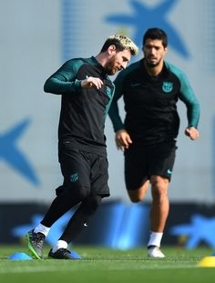 Lionel Messi and Luis Suarez of Barcelona warm up during the FC Barcelona training session at Ciutat Esportiva Joan Gamper on October 18, 2016 in Barcelona, Catalonia.
