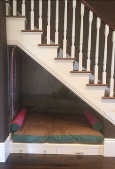 Dog House under the stairs. Try out the noise level when the kids race down the stairs before going for this option