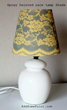 Lace spray paint lamp shade- paint shade under color & let dry. Use temp spray adhesive to lay lace on shade (smooth flat or pattern will be blurred) Spray paint over lace. Remove lace & let dry.