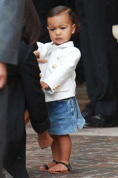 To aid Kim Kardashian's continued attempts to persuade North to participate in her mommy-and-me styling, Olivier Rousting sent over some custom, baby-size Balmain blazers to match her parents'.