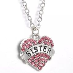 "Sister Necklace✨6 available✨ Cute silver toned zinc alloy necklace. This has pink rhinestones. Chain is 24"" plus 2"" extender. New in package. Your sister will love it! Jewelry Necklaces"