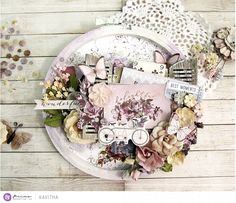 """""""The new shutters and the Lavender collection inspired me to make a garden-themed project. I altered an embroidery hoop with lots of gorgeous Lavender collection flowers and fussy-cut butterflies. I added a hint of color with oil pastels and added art stones for some texture. Doesn't this collection look so delightful?"""" ~ Kavitha"""
