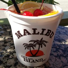 5 different flavors of Malibu rum with pineapple, orange and cranberry juice. I'm ready for Dimitri's, the beach and a Rum bucket. Luau Drinks, Fruity Drinks, Party Drinks, Wine Drinks, Cocktail Drinks, Alcoholic Drinks, Cocktails, Summer Mixed Drinks, Cranberry Juice