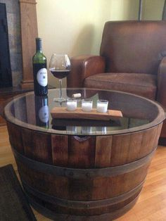 Old wine barrel converted into a coffee table. Another great idea for a home library.